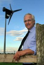 Paul Henstridge with the wind turbine in his garden in Holmesfield, Derbyshire - David Bocking - 02-10-2006