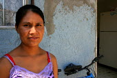 Rosa Zarate and her family are Zapotec Mexican immigrants from Ajutla in Oaxaca. Zarate takes care of children while other families work. She lives in one of a number of rundown apartment houses in Ta... - David Bacon - 10-06-2006