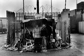 Pickets with their hut and brazier at the dock gates during the two and a half year long dock dispute during which 400 dockers were sacked for refusing to cross a picket line, during which time the st... - David Sinclair - 12-09-1997