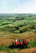 Edale and Buxton Mountain Rescue teams lifting a man injured in a hang glider accident off the Mam Tor hillside in Derbyshire - David Bocking - 10-08-1998