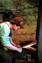 Blade grinder grinding an ice skate blade in his workshop in Sheffield - David Bocking - 30-05-1999