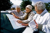 Weavers Way walk. Retired women seen map reading on the roof of their car in the National Trust Felbrigg Hall car park. - David Mansell - 17-09-2001
