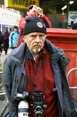 David Bailey 65 year old, famous 1960's fashion photographer seen working during the Anti Iraq War Demonstration in London on Saturday 15 February 2003. - David Mansell - 15-02-2003
