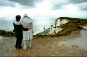 Beachy Head in East Sussex, favoured spot for suicides. Old people enjoying the view. - David Mansell - 2000s,2004,adult,adults,age,ageing population,Area,chalk,cliff,cliffs,coast,coastal,Coastal Erosion,coasts,country,countryside,couple,COUPLES,downland,elderly,eni environmental issues,enjoying,ENJOYME