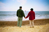 Southwold in Suffolk  Old couple on the beach holding hands and looking out to sea - David Mansell - 10-07-2003