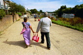 Tales of the Riverbank walk. The walk goes from Richmond to Teddington lock through the village of Twickenham An elderly Indian couple walking along the footpath at Richmond. - David Mansell - 11-08-2001