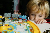 Thomas the Tank Engine, one of the best selling children's toys is being played with by 3 year old Johnnie Walkins, at Hamleys Store, London. - David Mansell - 23-10-2005