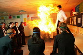 Chemistry teacher demonstrates how exciting practical chemistry lessons can still be taught in the classroom. Neil Dixon is with his GCSE fifth form pupils at the south Bromsgrove Community School, Br... - David Mansell - 09-11-2005
