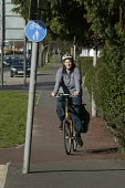 A woman cyclist using a cycle route in Aylesbury, Buckinghamshire.  cycling bicycles - David Mansell - 08-02-2008