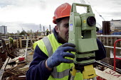 A surveyor seen using his theodolite at the construction and engineering work being undertaken by British Waterways to build a set of lock gates on the River Lee, which will enable heavy building mate... - David Mansell - 07-04-2008