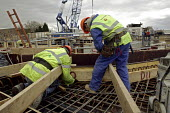 Construction workers. Construction and engineering work undertaken by British Waterways, to build a set of lock gates on the River Lee which will enable heavy building materials to be carried by river... - David Mansell - 07-04-2008