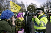 Anti-nuclear campaigners, dressed up as circus clowns tormenting a police officer who is using a camera to record the faces of people gathered outside the Atomic Weapons Establishment at Aldermaston,... - David Mansell - 24-03-2008
