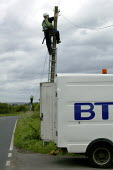 BT engineer up a telegraph pole repairing broken telephone cables that were damaged by high winds in Oxfordshire. - David Mansell - 09-07-2007
