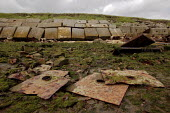 The remains of sheets of amoured plated steel, pierced by a shell holes. At Shoeburyness, an MOD weapons testing site, east of Southend on Sea, in Essex. - David Mansell - 01-07-2007