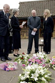 A family mourning at a funeral. - David Mansell - ,&,2000s,2007,adult,adults,belief,burial,casket,ceremonial,ceremonies,ceremony,christian,christianity,christians,cities,city,coffin,coffins,conviction,couple,couples,cremated,cremation,crematorium,dea