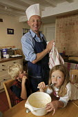 Guy Browning, a writer who has recently attended a basic novices cookery course, cooks fairy cakes with his children. - David Mansell - 14-08-2007