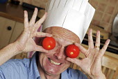 Guy Browning, a writer who has recently attended a basic novice's cookery course, having fun cooking with his family. - David Mansell - 2000s,2007,a,chef,chefs,chef's,cook,cookery,cooking,COOKS,EMOTION,EMOTIONAL,EMOTIONS,face,faces,funny,happiness,happy,hat,hats,having,having fun,Humor,HUMOROUS,HUMOUR,joking,kitchen,kitchens,laugh,LAU