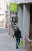 An unemployed young woman enters the Job Centre Plus building in Sheffield, Yorkshire. - David Mansell - 20-03-2009