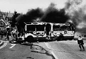 Rioting, The Bogside, Derry, Northern Ireland 1979, prior to the Annual Londonderry Apprentice Boys parade. A bus is highjacked and set on fire as rioting starts by a large group of catholic nationali... - David Mansell - 11-08-1979