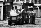Rioting, The Bogside, Derry Northern Ireland 1981. British soldiers shielding themselves behind riot shields and Pig armoured vehicle as they come under attack from rioters throwing petrol bombs.The I... - David Mansell - 25-04-1981