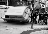 Rioting, The Bogside, Derry, Northern Ireland 1981 after the death of IRA prisoner Bobby Sands on hunger strike. Young rioters have just stolen a local butchers van, they form part of a large group of... - David Mansell - 06-04-1981