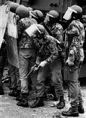 Rioting, The Bogside, Derry, Northern Ireland 1979 A soldier with a Swastika scratched on the side of his helmet- strongly associated with fascism and nazism. Rioting started in the Bogside of Derry a... - David Mansell - 04-08-1979