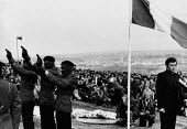 Funeral of Patsy OHara an INLA volunteer and the third hunger striker to die on 21 May 1981, his funeral was the biggest seen in Derry. At the graveside three volleys were fired by firing party. There... - David Mansell - , unrest conflicts conflict,1980s,1981,aim,aiming,armed forces,armed weapon weapons,arms,arms armed,Catholic catholics,Derry,fire,firearm firearms,fires,firing,flag,flags,funeral,FUNERALS,gun,gunmen g
