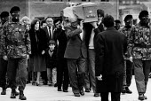 Funeral of the IRA prisoner Bobby Sands, 1981 his coffin is carried by his father and brother at the front, with Owen Carron who preceded Sands as MP for Fermanagh and South Tyrone, followed by Sands... - David Mansell - 1980s,1981,armed forces,Belief,casket,Catholic catholics,coffin,conflicts conflict,disputes,FEMALE,funeral,FUNERALS,gunmen gunman,hunger,hunger strike,imprisonment,incarcerated,incarceration,INMATE,IN