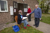 A political party polling station teller seen outside The Boy Scout and Girl Guide hut that was used as one of the Polling Stations in Dorchester in the Dorset West Constituency of the 2010 General El... - David Mansell - 06-05-2010