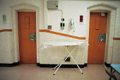 A day in the life of the inmates and staff of Kingston prison, Portsmouth. General view of the corridor and cells of the prison. An ironing board for the prisoners' use. - David Mansell - 16-01-2001