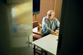 A day in the life of the inmates and staff of Kingston prison, Portsmouth. A prisoner, Geordie, who is serving life for murder, is seen here in the 'E-wing' for elderly prisoners. This is a unique win... - David Mansell - 16-01-2001