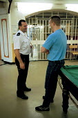 A day in the life of the inmates and staff of Kingston Prison, Portsmouth. A prison officer talks to an inmate who is serving life for murder. - David Mansell - 16-01-2001
