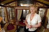 Maggie Smith-Bendell is a Romani Gypsy standing inside her traditional gyspy caravan, although 69 years old is still campaigning for better conditions for travellers. She is a writer and has recently... - David Mansell - 2010,2010s,ACE,activist,activists,adult,adults,age,ageing population,arts,author,authoress,authors,BAME,BAMEs,BME,bmes,campaign,campaigner,campaigners,campaigning,CAMPAIGNS,caravan,caravans,culture,di