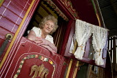 Maggie Smith-Bendell is a Romani Gypsy standing inside her traditional gyspy caravan, although 69 years old is still campaigning for better conditions for travellers. She is a writer and has recently... - David Mansell - ,2010,2010s,ACE,activist,activists,adult,adults,age,ageing population,arts,author,authoress,authors,BAME,BAMEs,BME,bmes,campaign,campaigner,campaigners,campaigning,CAMPAIGNS,caravan,caravans,culture,d