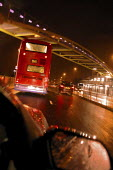 Following behind a London double decker bus. Continual heavy rain makes driving conditions difficult for traffic leaving London on the A40. - David Mansell - ,2000s,2009,adult,adults,at,bus,bus service,buses,cab,cabs,cas,cities,city,CLIMATE,COMMUTE,commuter,commuters,commuting,conditions,dark,Double Decker,driver,drivers,driving,EBF,Economic,Economy,employ
