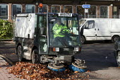 Merthyr Tydfil Council workers using a motorised roadsweeper to collect and remove autumn leaves, Merthyr Tydfil, Wales. - David Mansell - 08-11-2010