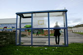 Waiting at the bus stop on the 1950s Gurnos council housing estate based on the Radburn system. Merthyr Tydfil has high levels of long term unemployment. It has the highest number of people claiming s... - David Mansell - 08-11-2010