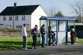 Unemployed people queuing at a bus stop, Twyncarmel Estate in Merthyr Tydfil. Merthyr Tydfil has very high levels of unemployment. - David Mansell - 2010,2010s,bus,bus service,Bus Stop,BUSES,communities,community,council estate,council services,council estate,council services,EBF,Economic,Economy,FEMALE,house,houses,Housing Estate,jobless,jobseeke