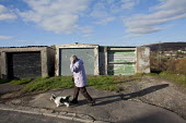 A retired pensioner using her mobile, as she walks her dog on the Twyncarmel Estate in Merthyr Tydfil. - David Mansell - 10-11-2010