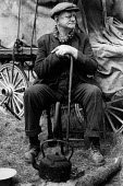 The Appleby Horse Fair, 1978 Finger Joe Henderson a Gypsy from Bishop Auckland in his camp The Appleby Horse Fair 1978 with a hoop topped wagon and campfire. Around ten thousand English and Welsh Gyps... - David Mansell - 08-06-1978