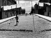 Cobbled streets, a washing line and children playing football, housing in Keightley, Yorkshire - David Mansell - ,1970s,1978,asian,asians,BAME,BAMEs,Black,BME,bmes,boy,boys,child,CHILDHOOD,children,council estate,council services,council estate,council services,diversity,ethnic,ethnicity,football,house,houses,ho