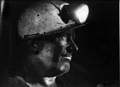 Miner underground wearing a pit helmet and miners lamp, Snowdown colliery, NCB, Kent April 1971 - David Mansell - ,1970s,1979,capitalism,capitalist,Coal Industry,Coal Mine,coalfield,coalindustry,collieries,colliery,EBF,Economic,Economy,employee,employees,Employment,extracting,Industries,industry,job,jobs,lbr,make