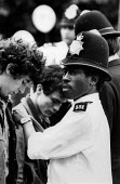 Stop and Search, Nottinghaill Carnival, London 1978 - David Mansell - ,1970s,1978,BAME,BAMEs,black,BME,bmes,CLJ,cultural,diversity,ethnic,ethnicity,London,looking,male,man,men,minorities,minority,multi,multi cultural,MULTI RACIAL,multicultural,multiracial,people,person,
