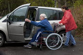 Getting into the car. Malcolm and Ruth Parker leaving their home in Fleet, Hampshire. Malcolm who at 63 yrs is to have his disability payments reduced by government cut backs due to the fact his wife... - David Mansell - 28-04-2013
