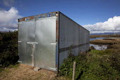 A shipping container being used to store winter feed near Letterfrack, Connemara, County Galway - David Mansell - Irish,2010s,2012,agricultural,agriculture,arable,boat,boats,capitalism,capitalist,container,containers,crop,crops,EBF,Economic,Economy,farm,farmed,farming,farmland,farms,grower,growers,growing,hay,hig
