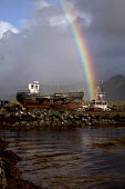 Derelict fishing boats, Derryinver Pier, Letterfrack, Connemara, County Galway. And rainbow. EU Common Fisheries Policy has led to the contraction of the Irish fishing industry - David Mansell - 05-10-2012