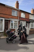 Muslim mothers pushing prams, Sparkhill, Birmingham - David Mansell - 2010s,2012,adult,adults,babies,baby,BAME,BAMEs,Birmingham,Black,BME,bmes,british,burka,burkas,burqa,burqas,chair,chairs,child,CHILDHOOD,children,cities,city,daughter,daughters,diversity,dress,EARLY YE