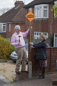 Liberal Democrat candidate Lucille Thompson and her councillor husband Andrew Thompson putting up election posters in the Hampshire town of Winchester, where the Liberal Democrats hold controlling pow... - David Mansell - 23-04-2012