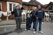 Annual Horse Fair, Wickham, Hampshire, The Wilson Family, Joe Wilson and his two sons and grandson - David Mansell - 2010s,2012,ACE,animal,animals,BAME,BAMEs,BME,bmes,boy,boys,buy,buyer,buyers,buying,call,calls,CELLULAR,child,CHILDHOOD,children,commodities,commodity,communicating,communication,culture,DAD,DADDIES,DA