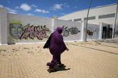 Muslim woman walking past a mural, Spain - David Mansell - 24-05-2013